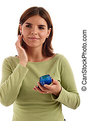 Beauty product - Portrait of a young woman holding facial...