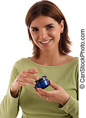 Beauty product - Portrait of a pretty young woman holding...