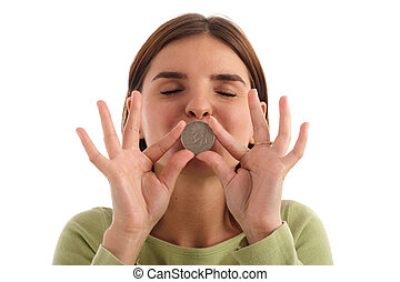 Kissing the coin - Portrait of a young pretty woman kissing...