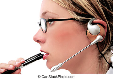 Customer Service - Woman with telecoms headset and pen