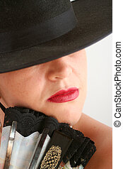 mysterious woman - Spanish woman with hat and fan
