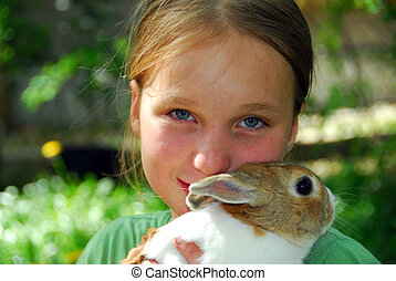 Girl and bunny - Young girl holding a bunny