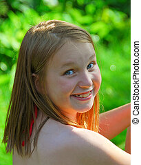 Girl child summer - Portrait of a smiling young girl in...
