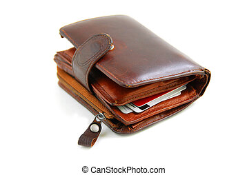 Old wallet - Old leather wallet full of credit cards on...