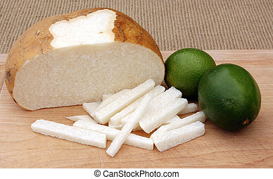Jucama and Limes - Image of sliced jicama and ripe limes