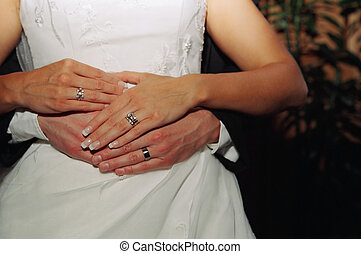 Wedding couple holding hands - Bride groom holding hands and...