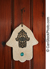 hamsa hand amulet, used to ward off the evil eye in...