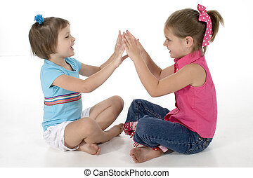 Clapping Games - Two sisters, 4 and 6, playing clapping...