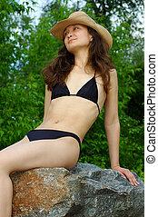 Pretty girl in bikini outdoor - Beautiful young woman in...