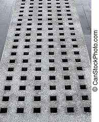 Concrete perforation - Concrete block with square shaped...
