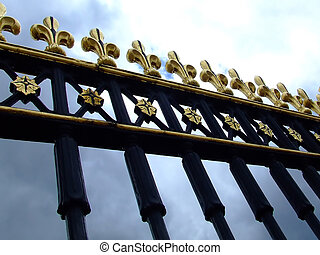 Gate detail - Detail of a gate with sky in background