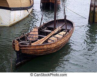 Vintage row boat near the Mayflower in Plymouth,...