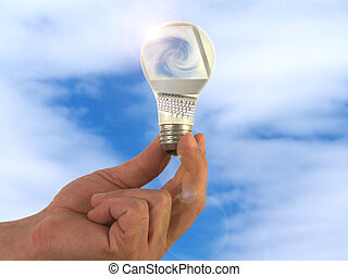 Ideas and Computers - Hand holding light bulb with computer...