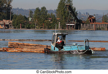 Log boom boat - boom boat pushing logs around in Pitt river