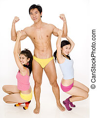 Guy and Two Girls - A muscular man with two female fans...