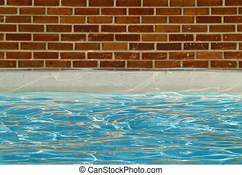 swimming pool - a swimming pool surrounded by a brick wall