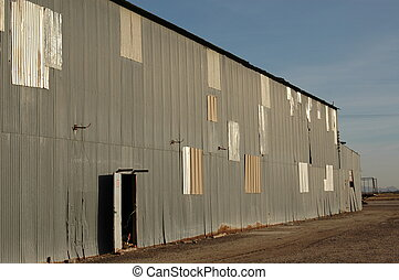 Abandoned Warehouse - Abandoned agricultural warehouse with...
