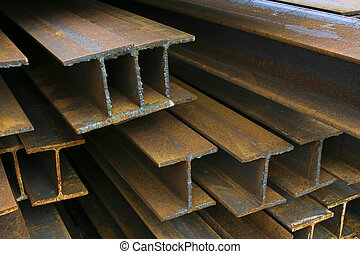 Construction Beams - Close-up of rusty steel beams stacked...