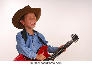Lonesome Cowboy 23 - Young boy playing electric guitar
