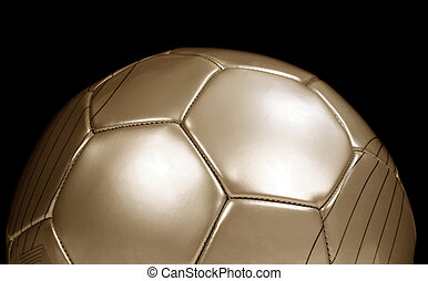gold football - Close up of a gold football on black