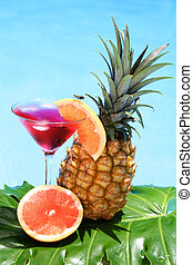 Tropical Cocktail - Tropical cocktail with fruit and blue...