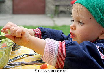 Barbecue - Little baby eating salad
