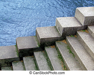 Water behind the stairs - Stairs on the river coast