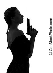 smoking gun - silhouette image of pretty girl with smoking...