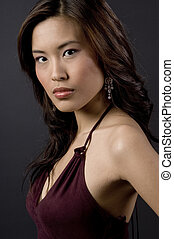 Asian Beauty - A beautiful young asian woman in a velvet...