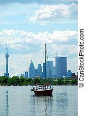 Toronto city skyline with a sailboat
