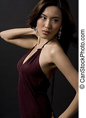 Model Pose - A beautiful asian model in an evening dress