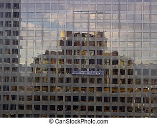 Window Washers - Window washers on office building in...
