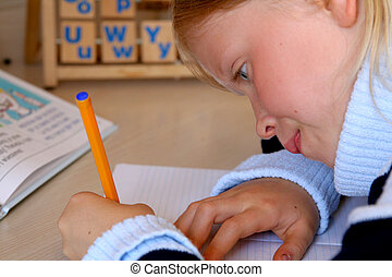 Learning alphabet - Little girl doing her homework