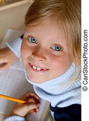 Learning alphabet - Little girl doing her homework