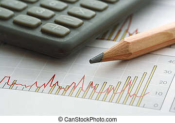 Pencil and Calculator on Chart (focus on the tip of the...
