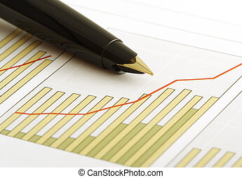 positive earning chart - A pen on a positive earning...