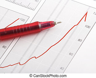 pen on positive earning chart(focus on the tip of the pen)