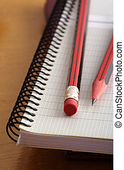 Pencils on Notebook - Still-life of two pencils on a...