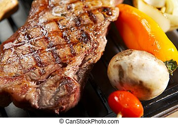 Isolated BBQ steak dinner - grill