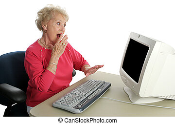 Shocking Content - A senior woman viewing shocking internet...