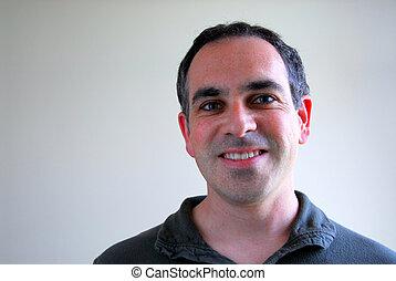 Man portrait - Portrait of a smiling man on plain background