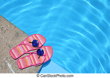 Shoes by Pool - Pink flip-flops and sunglasses by blue pool