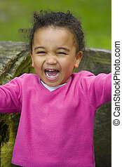 Laughing Out Loud - A beautiful mixed race girl sitting on a...