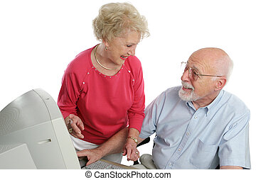 Older Couple Online - An attractive retired couple surfing...
