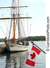 docked sailboat - sailboat with Canadian flag in forefront