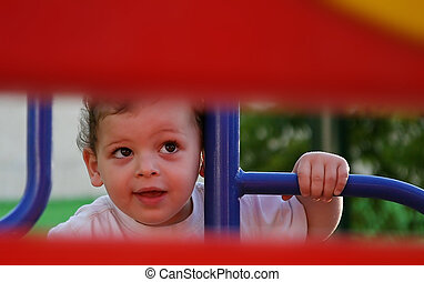 boy enjoys the playground