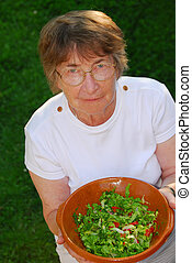 Healthy senior woman - Happy senior woman with bowl of salad...
