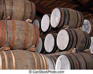 Whisky barrels stacks in a distillery cellar.