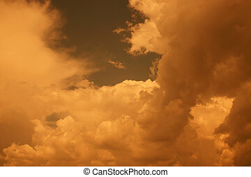 Golden Clouds II - Clouds of a thunderstorm through a gold...