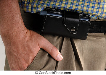 PDA Cellphone - Man Wearing A Smartphone In A Leather Belt...
